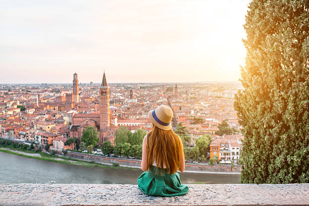 woman enjoying beautiful view on verona city - europareisen stock-fotos und bilder