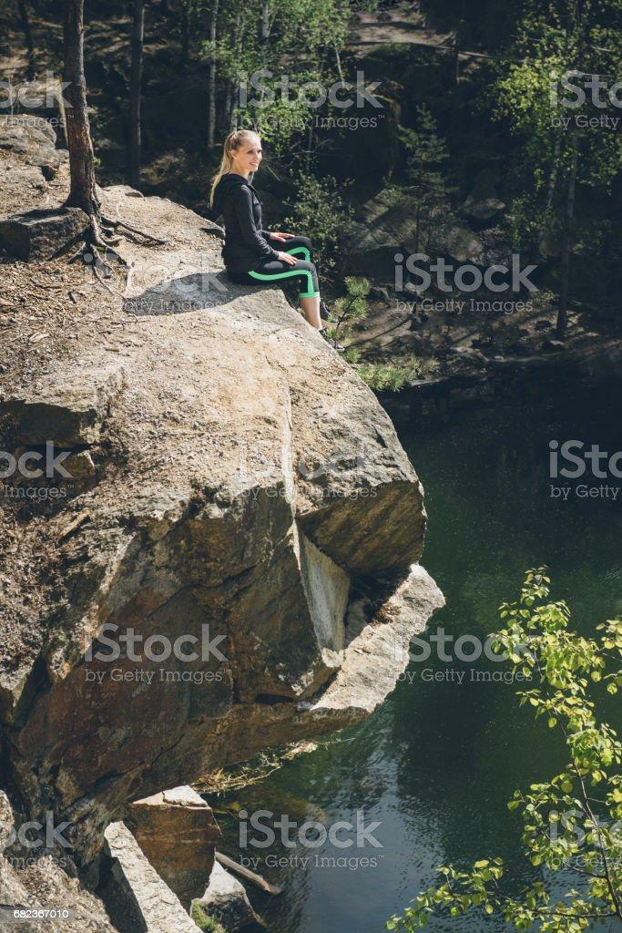 woman enjoying blue lake water on the high cliff in summer royaltyfri bildbanksbilder