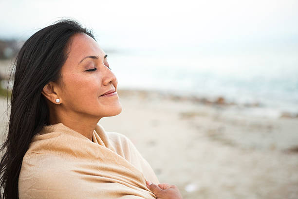 Woman enjoying creation Woman relaxing at the beach eyes closed woman stock pictures, royalty-free photos & images