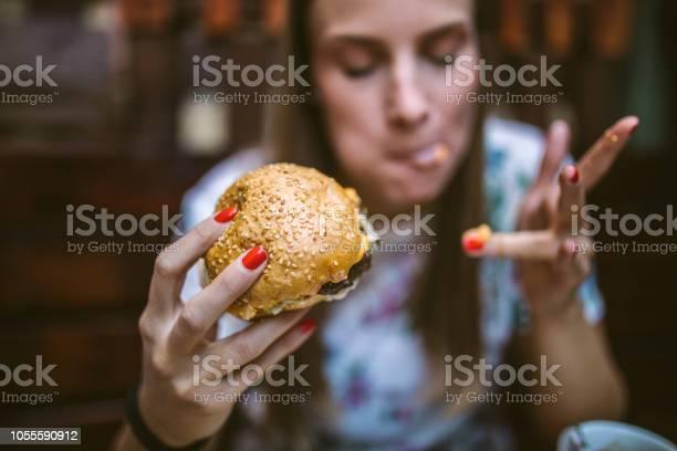 Woman enjoying delicious burger picture id1055590912?b=1&k=6&m=1055590912&s=612x612&h=1j1zbjtgcte gcx76gegrpf7k yecpn2hxx0xaxrqgy=