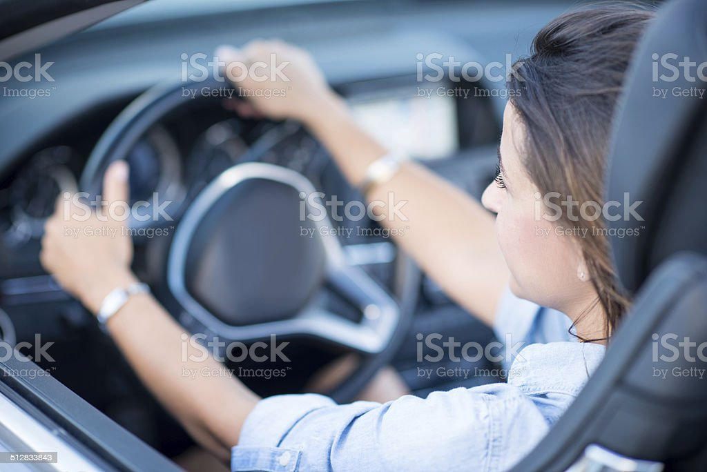 Woman enjoying driving stock photo