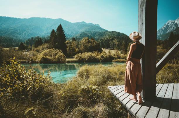 Woman enjoying freedom on nature outdoors. Travel Slovenia Europe. stock photo