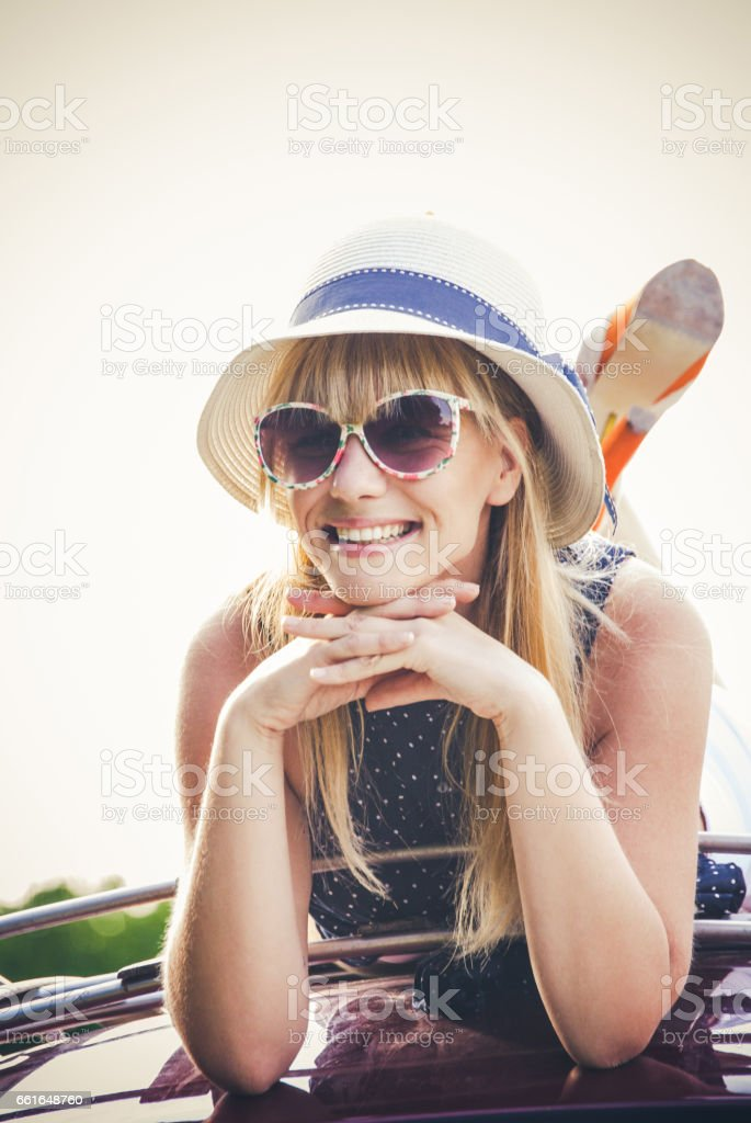 Woman Enjoying Freedom On The Top Of The Car Roof - Old Fashioned stock photo