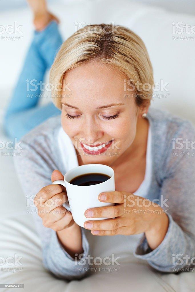 Woman enjoying her coffee royalty-free stock photo