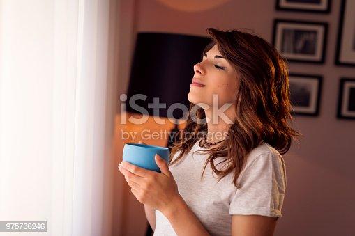 istock Woman enjoying her morning coffee 975736246