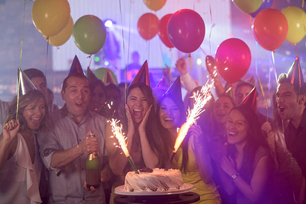 woman enjoying her surprise birthday party - geburtstagsgratulation stock-fotos und bilder
