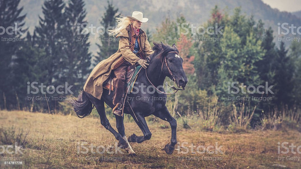 Woman enjoying horse riding stock photo