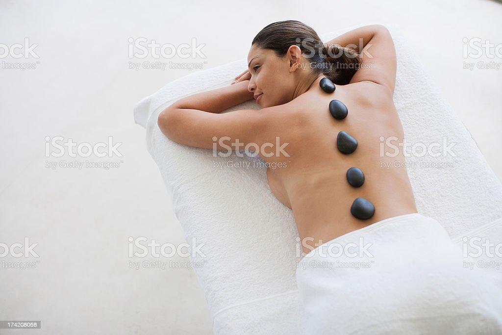 Woman enjoying hot stone therapy royalty-free stock photo