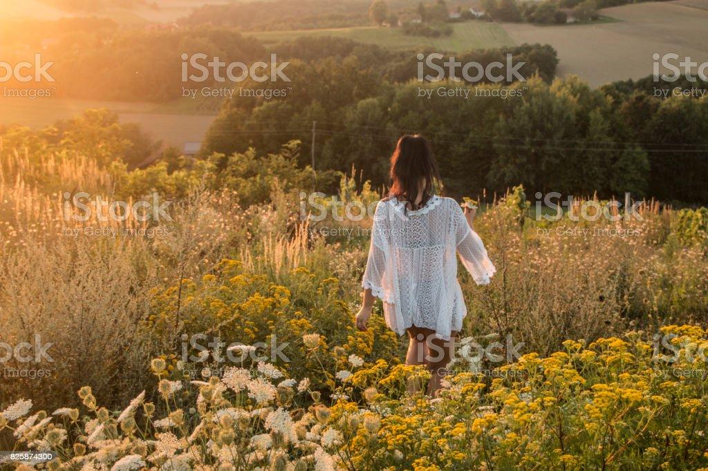 Woman enjoying in sunset stock photo