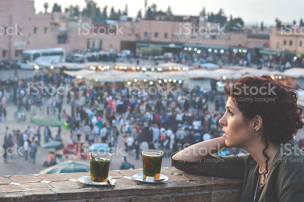 Woman enjoying in tea on balcony stock photo