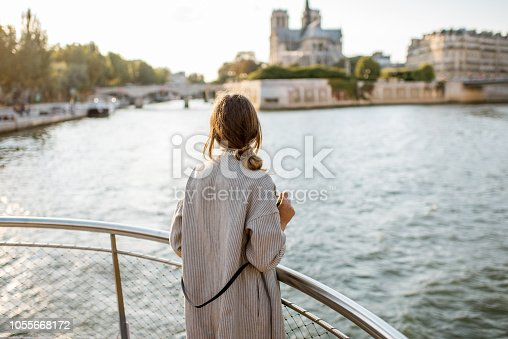 istock Woman enjoying landscape view on Paris city from the boat 1055668172