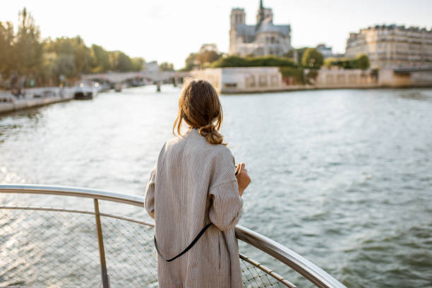 woman enjoying landscape view on paris city from the boat - cruise foto e immagini stock