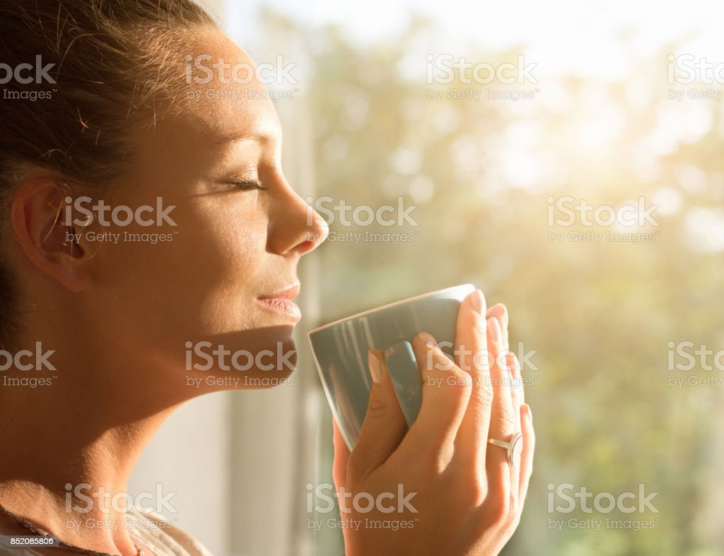 Woman enjoying morning coffee royalty-free stock photo