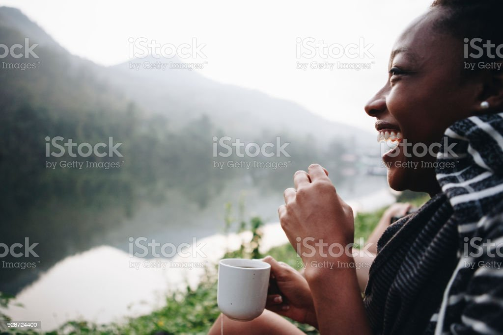 Woman enjoying morning coffee with nature stock photo
