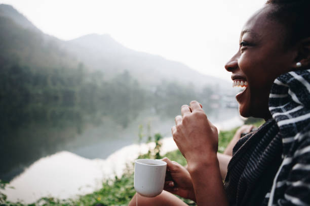 Woman enjoying morning coffee with nature stock photo
