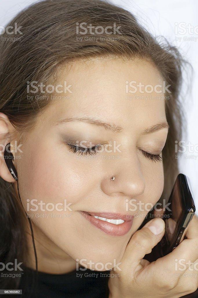 Woman enjoying music royalty-free stock photo