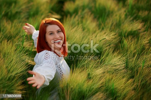 High angle view of redhead enjoying crop wheat in the agricultural field