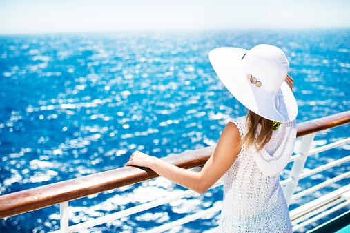 Walking along the deck of a cruise ship at sea