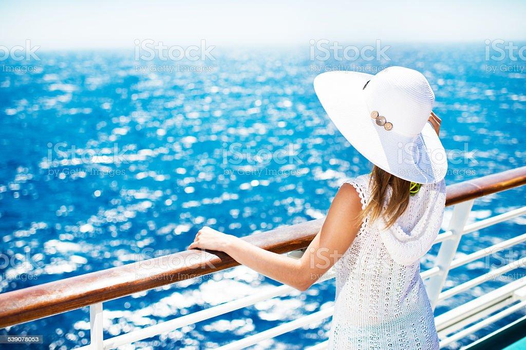 Woman enjoying on a cruise. stock photo