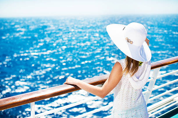 woman enjoying on a cruise. - cruise ship stock photos and pictures