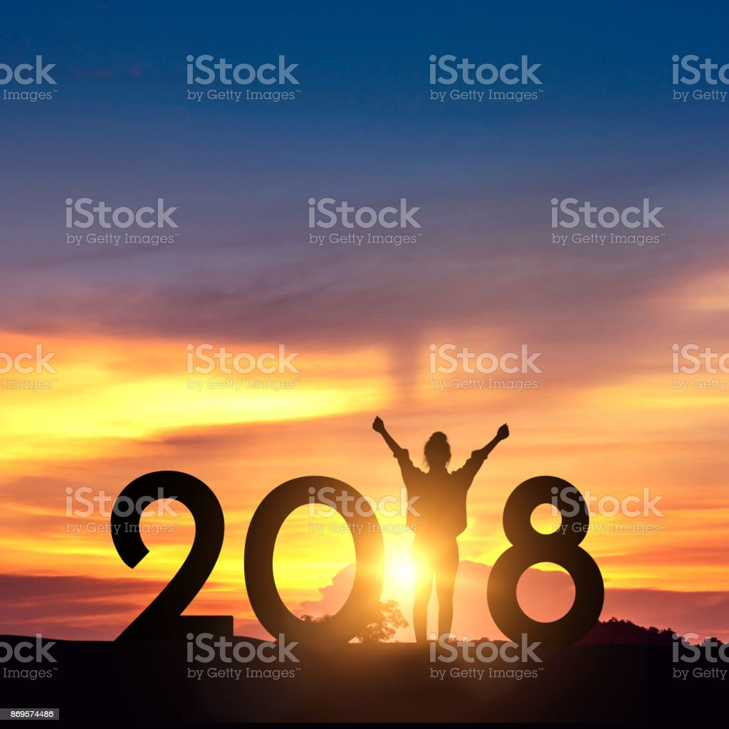 Woman enjoying on the hill and 2018 years while celebrating new year stock photo