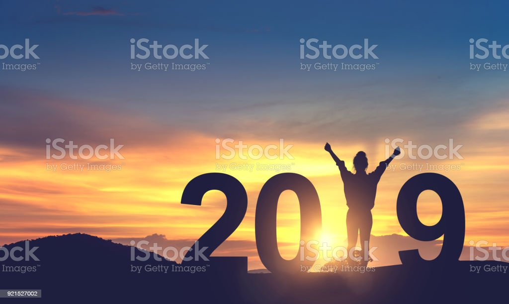 Woman enjoying on the hill and 2019 years while celebrating new year stock photo