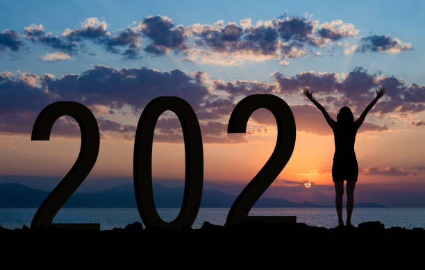 Woman enjoying on the hill while celebrating new year 2021