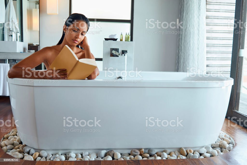 Woman Enjoying Reading A Book In A Bathtub Stock Photo & More ...