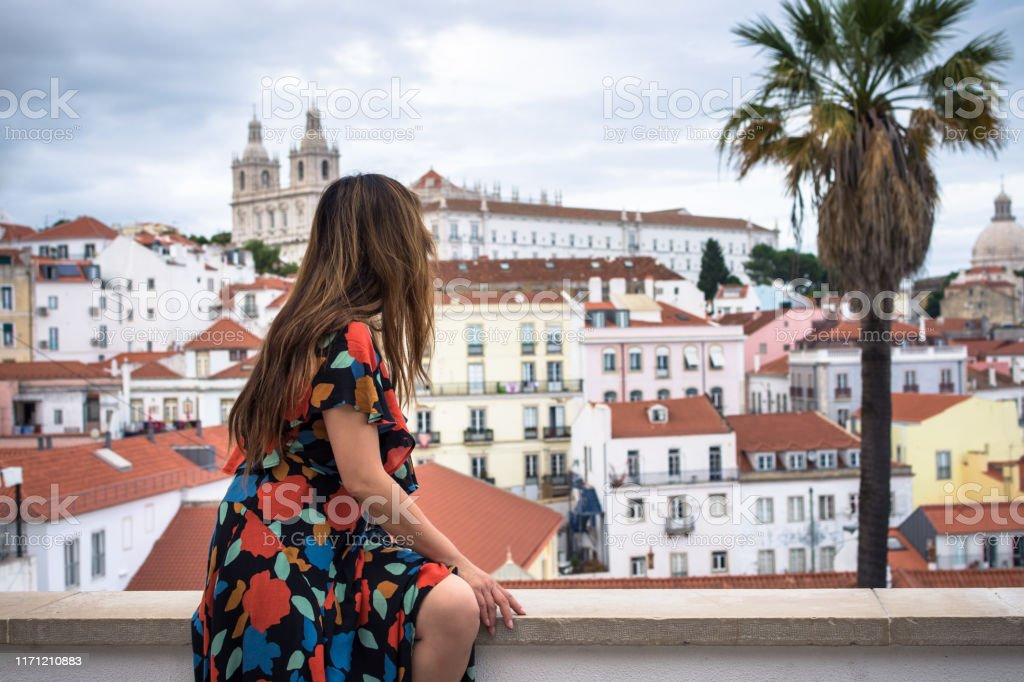 Woman enjoying rooftop view of Alfama District - Lisbon, Portugal - Royalty-free Adult Stock Photo