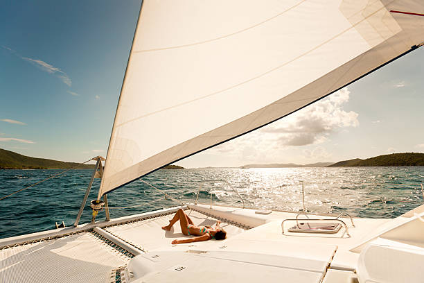 woman enjoying sailing through the caribbean on a catamaran - katamaran bildbanksfoton och bilder