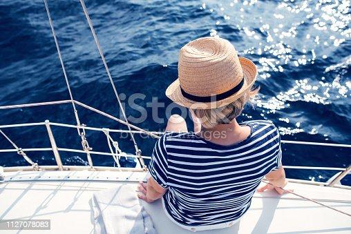 879618770 istock photo Woman Enjoying Sea on Sailboat 1127078083
