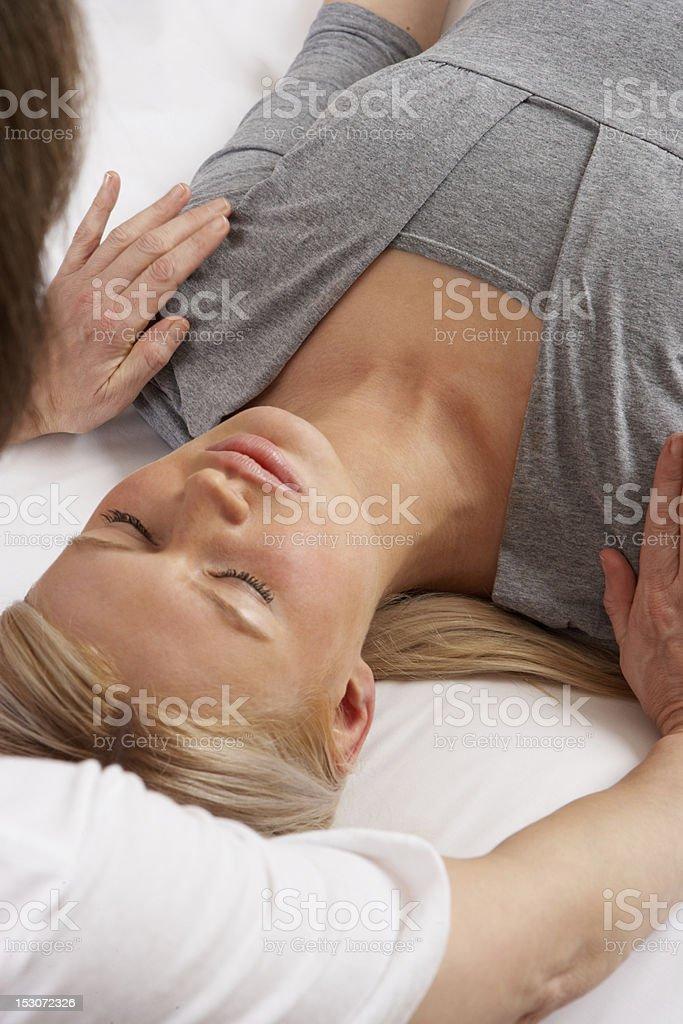 Woman enjoying Shiatsu massage royalty-free stock photo