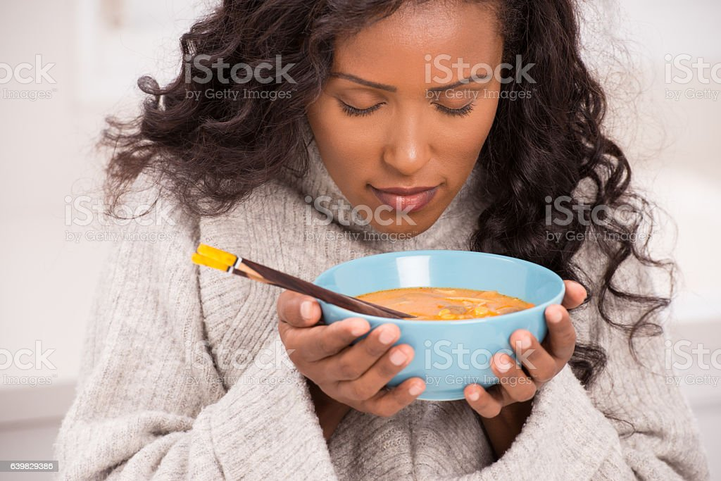Woman enjoying soup. stock photo