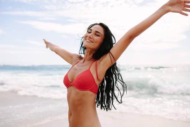 Woman enjoying spending time on the beach stock photo