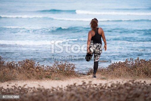 istock Woman enjoying stretching her leg outdoors. 822592986