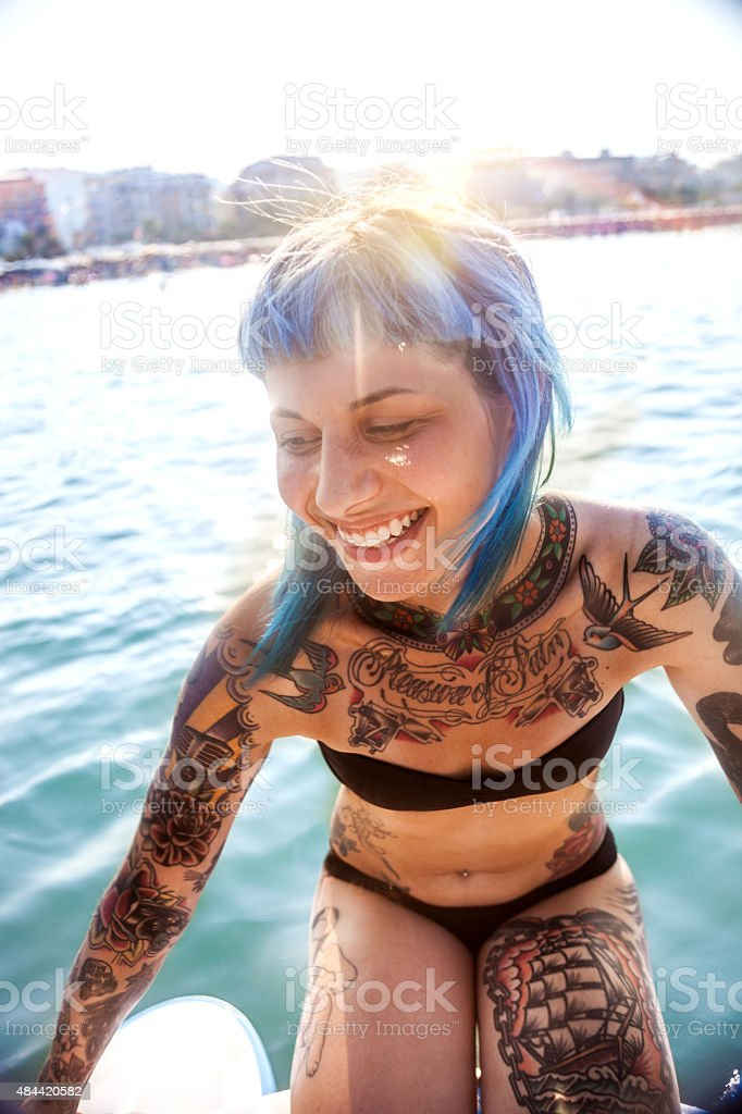 Woman enjoying summer and pedalo fun stock photo