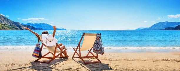 Woman enjoying sunbathing at beach picture id1143784231?b=1&k=6&m=1143784231&s=612x612&w=0&h=jzfwx1k5l21 zxa21tk ydgnidswuhcykz jyq3aoss=