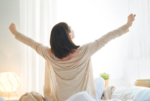 woman enjoying sunny morning stock photo
