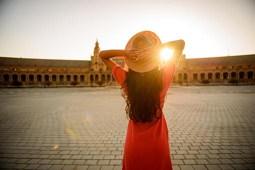 istock Woman enjoying sunrise. 1048636150