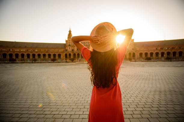Woman enjoying sunrise. Woman enjoying sunrise above Plaza de Espana in Seville, Spain seville stock pictures, royalty-free photos & images