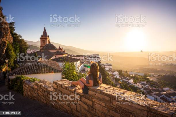 Woman enjoying sunset from zahara de la sierra in spain picture id1184059965?b=1&k=6&m=1184059965&s=612x612&h=up yuijxr yh9lqbzranhwgga ixukohsyn8el2ymxu=