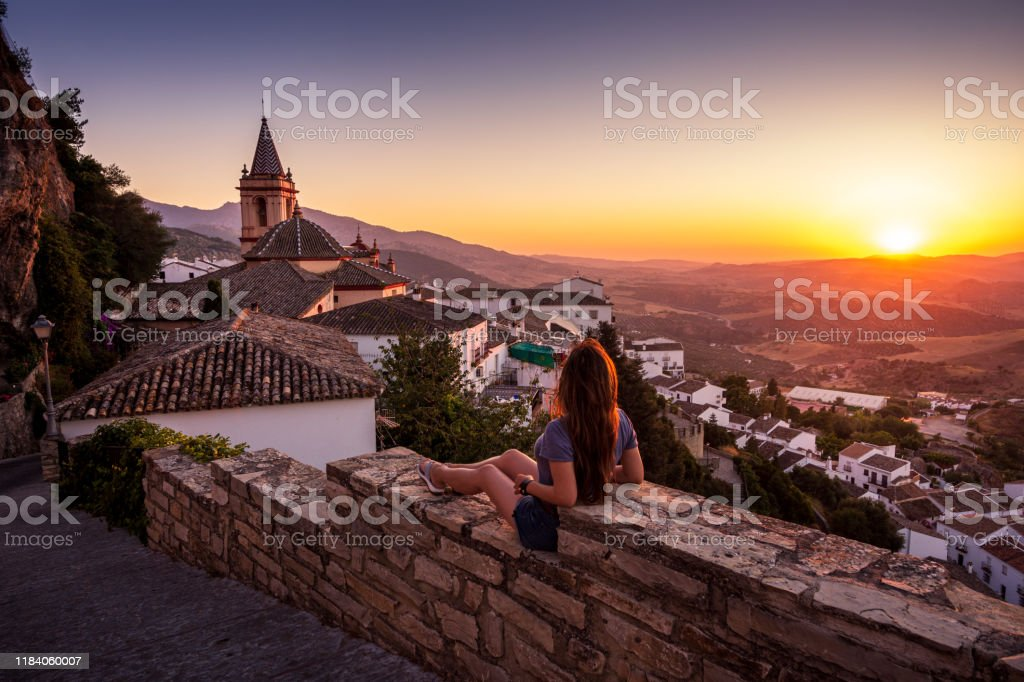 Woman enjoying sunset from Zahara de la Sierra in Spain - Royalty-free Adult Stock Photo