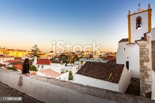 The whitewashed Santiago Church or Igreja de Santiago is located near the castle in the picturesque town of Tavira, Portugal. Originally built in the mid 13th century, the church was rebuilt in the 17th century due to earthquake damage.