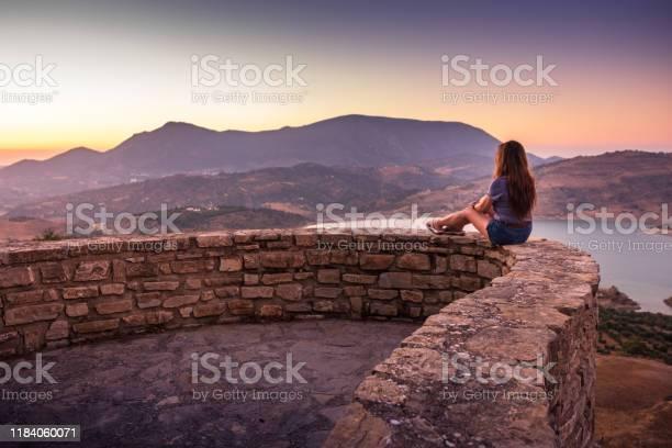 Woman enjoying sunset view of zaharael gastor reservoir from zahara picture id1184060071?b=1&k=6&m=1184060071&s=612x612&h=gu9ls 90a5vvtzjylknzab1z4ztbyeexo7lvx6t2two=