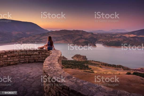 Woman enjoying sunset view of zaharael gastor reservoir from zahara picture id1184060077?b=1&k=6&m=1184060077&s=612x612&h=iripwh3lvmoejd55yq9dicp3qj7bt9rnxtf6agxk4bg=