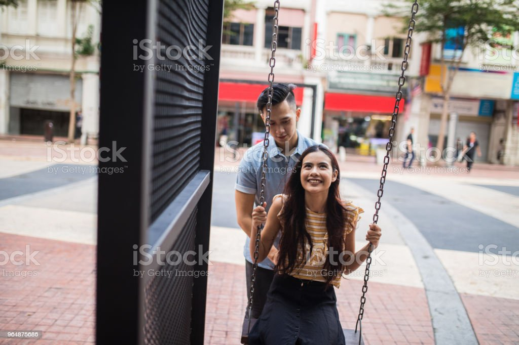 Woman enjoying swinging in Kuala Lumpur royalty-free stock photo