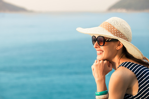 506662064 istock photo Woman enjoying the beautiful seaside view 472159562
