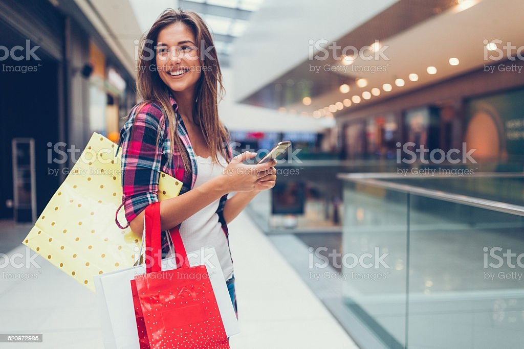 Woman enjoying the day in the shopping mall - Photo