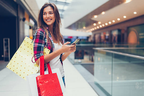 woman enjoying the day in the shopping mall - shopping stock photos and pictures