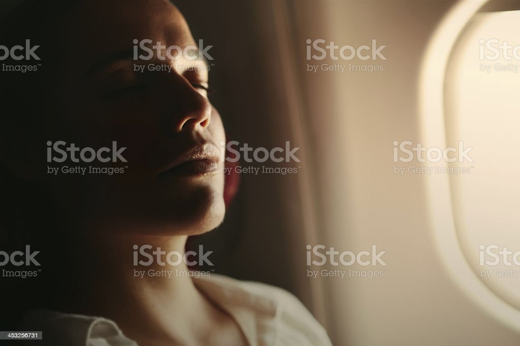 Woman enjoying the flight stock photo